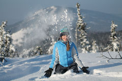Happy woman jumping at winter mountains, active female enjoying nature, Royalty Free Stock Images