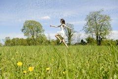 Happy woman jumping Royalty Free Stock Photos