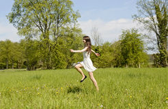 Happy woman jumping Stock Photo