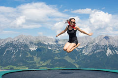 Happy woman jumping. Happy young woman jumping in the mountains Royalty Free Stock Photos