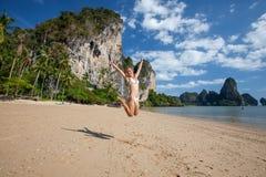 Happy woman jumps at the seashore Royalty Free Stock Photos