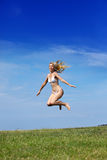 The happy woman jumps Royalty Free Stock Images