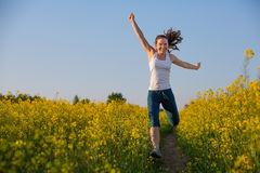 Happy woman jumps to the sky Royalty Free Stock Photo