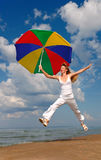 Happy woman jumps with umbrella Stock Photography