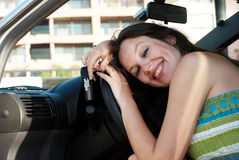 Happy woman in just bought car Royalty Free Stock Photo