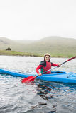 Happy woman in a kayak Stock Photography