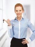 Happy woman with keys Royalty Free Stock Photos