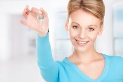 Happy woman with keys Stock Photo