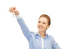 Happy woman with keys Stock Image