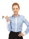 Happy woman with keys Royalty Free Stock Image