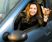 Happy woman with keys from her new car Stock Photos