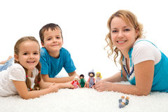Happy woman and kids playing on the floor Stock Image