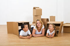 Happy woman and kids relaxing in their new home royalty free stock photography
