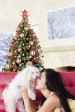Happy woman kiss her dog at home Stock Images