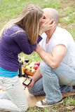 Happy woman kissing her boyfriend Stock Photography