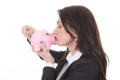 Happy woman kissing piggy Stock Image