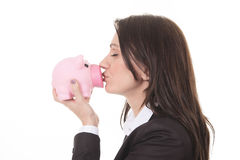 Happy woman kissing piggy Stock Image