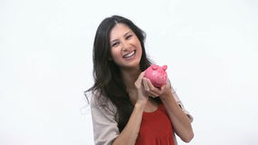 Happy woman kissing a piggy bank Royalty Free Stock Photos
