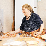 Happy woman at kitchen Royalty Free Stock Image