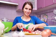 Happy woman in the kitchen stock image
