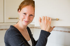 Happy Woman in a Kitchen Stock Image