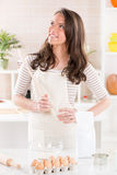 Happy woman in the kitchen Stock Photography