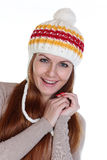 Happy woman in a knitted hat Royalty Free Stock Image