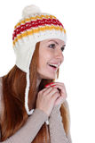 Happy woman in a knitted hat Royalty Free Stock Images