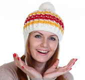 Happy woman in a knitted hat Stock Images
