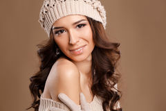 Happy woman in knitted sweater and hat. Stock Images