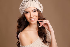 Happy woman in knitted sweater and hat. Royalty Free Stock Photo