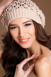 Happy woman in knitted sweater and hat. Royalty Free Stock Images