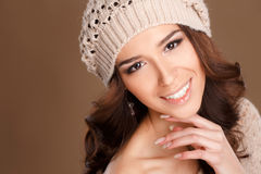 Happy woman in knitted sweater and hat. Royalty Free Stock Image