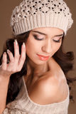 Happy woman in knitted sweater and hat. Stock Photo