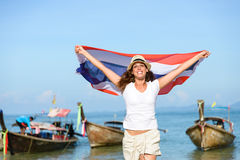 Happy woman at Krabi beach with Thailand flag Royalty Free Stock Images