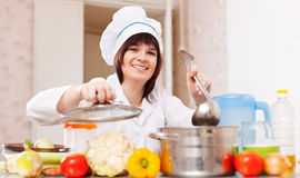Happy woman with ladle stock photos