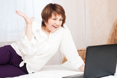 Happy woman with laptop Stock Image