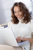 Happy woman with laptop Stock Photos