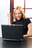 Happy woman on laptop Stock Images