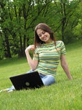 Happy woman with laptop Stock Images