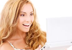 Happy woman with laptop computer Stock Photos