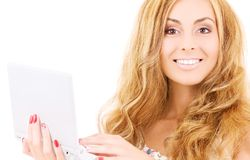 Happy woman with laptop computer Stock Images