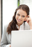 Happy woman with laptop computer Royalty Free Stock Photography