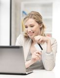 Happy woman with laptop computer and credit card Royalty Free Stock Image