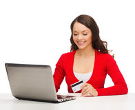 Happy woman with laptop computer and credit card Stock Image