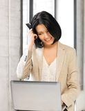 Happy woman with laptop computer and credit card Royalty Free Stock Photography