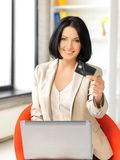 Happy woman with laptop computer and credit card Stock Images