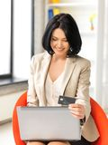 Happy woman with laptop computer and credit card Stock Photography