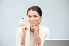 Happy woman with laptop computer and money Stock Photos