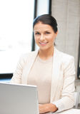 Happy woman with laptop computer Stock Image